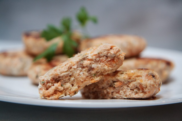 Flaky Rosemary Salmon Cakes against a blurred background.